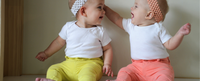 twin girls wearing yellow and pink